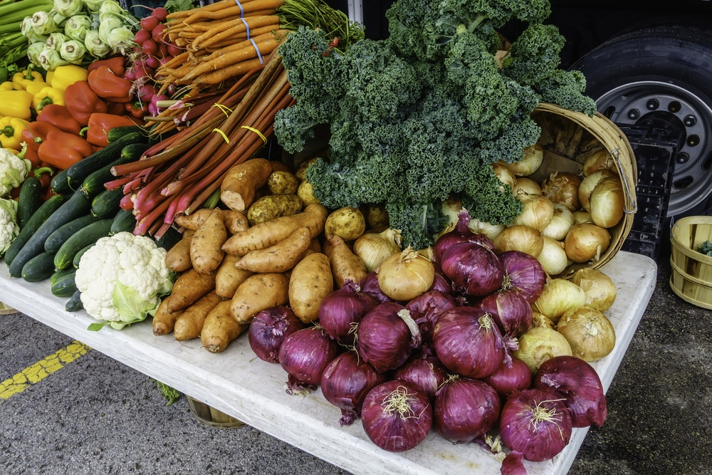 Variety of fresh vegetables on display at a farmer's market, late spring in northern Illinois, USA
